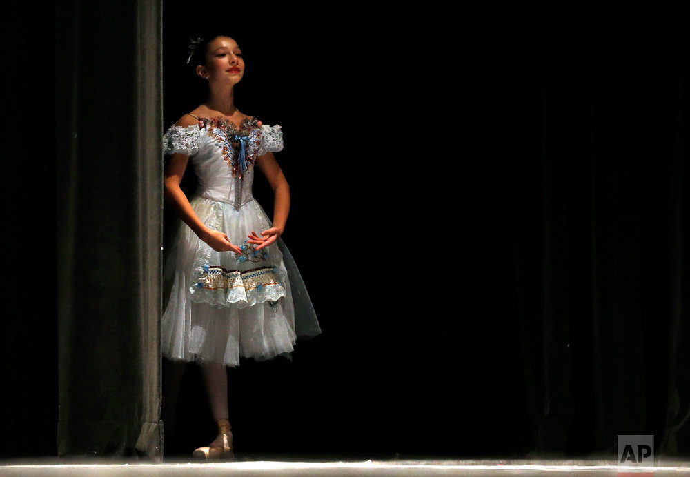 Anna Tsigler prepares to audition in the classical category for the Youth America Grand Prix regional semi-finals at Dominican University Performing Arts Center in River Forest, Ill., on Thursday, Feb. 2, 2017. Chicago is one of the 12 cities in North America selecting dancers who will compete in New York in April. (AP Photo/Nam Y. Huh)
