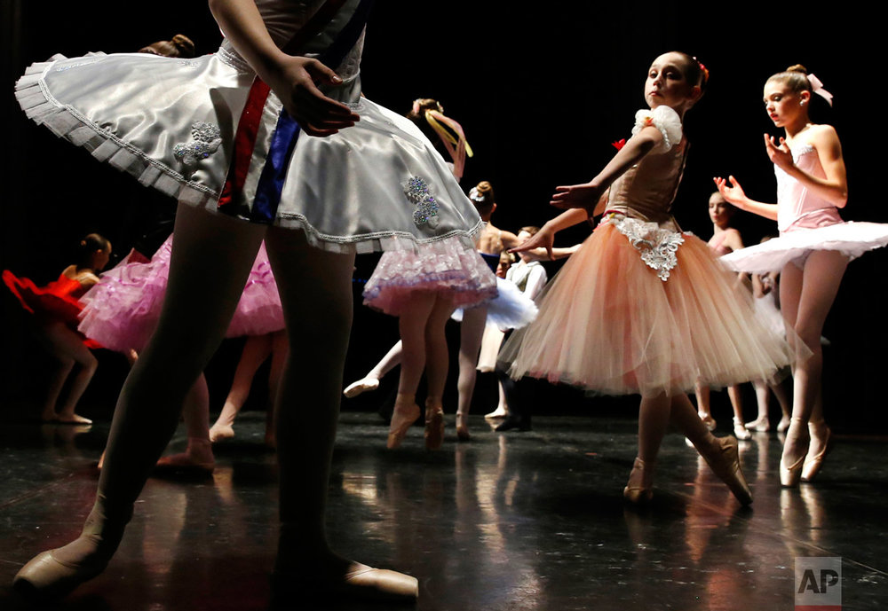Young ballet dancers warm up for the Youth America Grand Prix regional semi-finals at Dominican University Performing Arts Center in River Forest, Ill., on Thursday, Feb. 2, 2017. Hundreds of dancers between the ages of nine and 19 from the Chicago area auditioned for the YAGP regional semi-finals. (AP Photo/Nam Y. Huh)