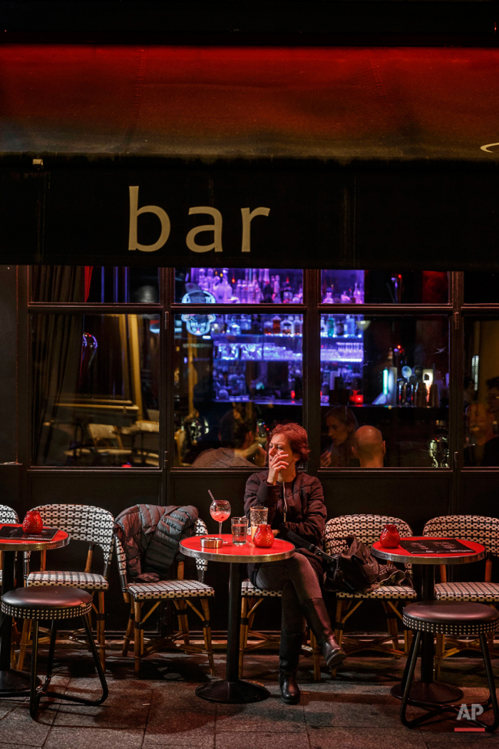 In this Nov. 17, 2015 picture people enjoy dinner at 'Iguana Cafe' close to one of the spots of Friday's attacks in Paris. Parisians are returning to cafes, bars and restaurants, determined that the Nov. 13 attacks won't alter the city's way of life. President Francois Hollande has told his compatriots that 'life must resumed in full,' asking: 'What would our country be without its cafes?'(AP Photo/Daniel Ochoa de Olza)