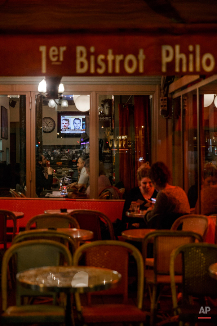 In this Nov. 17, 2015 picture people enjoy dinner at '1er Bistrot Philo'  close to one of the spots of Friday's attacks in Paris. Parisians are returning to cafes, bars and restaurants, determined that the Nov. 13 attacks won't alter the city's way of life. President Francois Hollande has told his compatriots that 'life must resumed in full,' asking: 'What would our country be without its cafes?'(AP Photo/Daniel Ochoa de Olza)