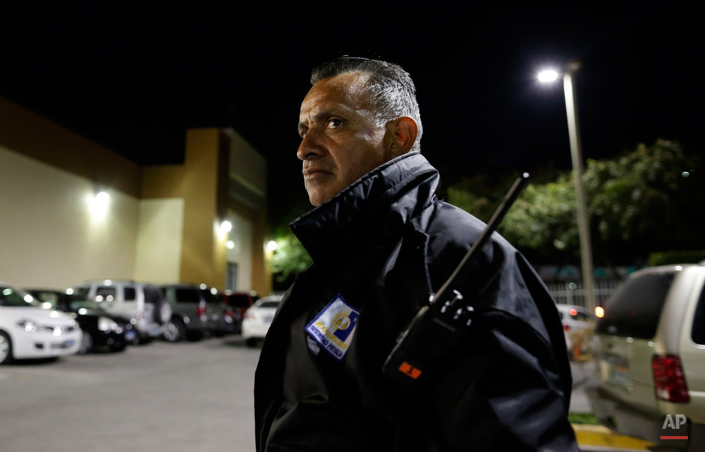Security guard Guillermo Soria looks on while working in front of a Smart & Final store Wednesday, Nov. 18, 2015, in Tijuana, Mexico. After living for nearly 25 years in the United States, Soria returned to Mexico and found work as a security guard. A new study finds more Mexicans are leaving the United States than coming to the country, marking a reversal to one of the most significant immigration trends in U.S. history. (AP Photo/Gregory Bull)