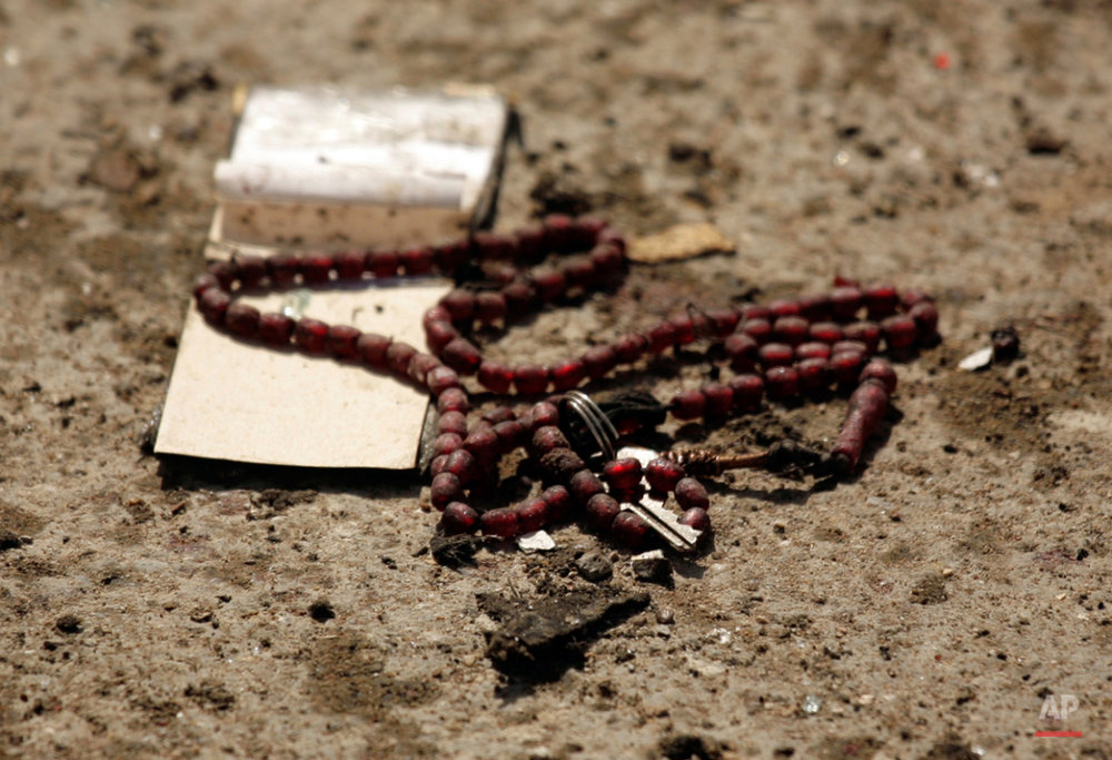 In this Wednesday, Oct. 8, 2008 photo, prayer beads are seen at the site after a female suicide bomber detonated an explosives vest, killing many people and wounding over a dozen in Baqouba, 35 miles (60 kilometers) northeast of Baghdad, Iraq. While most suicide bombers are men, Islamic militant groups have occasionally deployed women to carry out such attacks. Long before the rise of Islamic radicalism, women suicide bombers were used by leftist and separatist groups in the Arab and beyond. (AP Photo/Maya Alleruzzo)