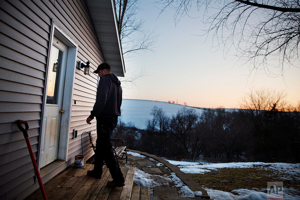 Jeff McCullick walks into his home in Ferryville, Wis., Wednesday, Jan. 18, 2017. McCullick voted for Donald Trump, with gun rights being a major factor in his decision. He's an avid hunter who feared Hillary Clinton's tougher stance on guns could ultimately lead to him losing his rifles and shotguns. (AP Photo/David Goldman)