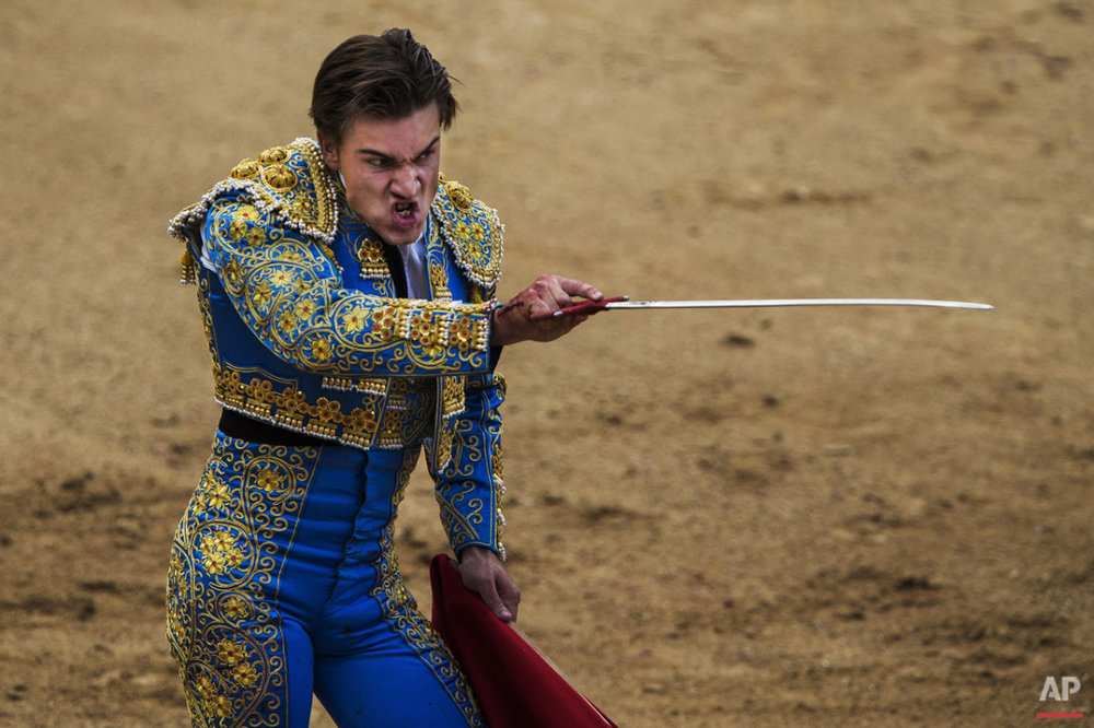 Bullfighter Luis Gerpe prepares his sword to kill a fighting bull during a bullfight at Las Ventas bullring in Madrid, Spain, Sunday, June 21, 2015. Bullfighting is a traditional spectacle in Spain and the season runs from March to October. (AP Photo/Andres Kudacki)