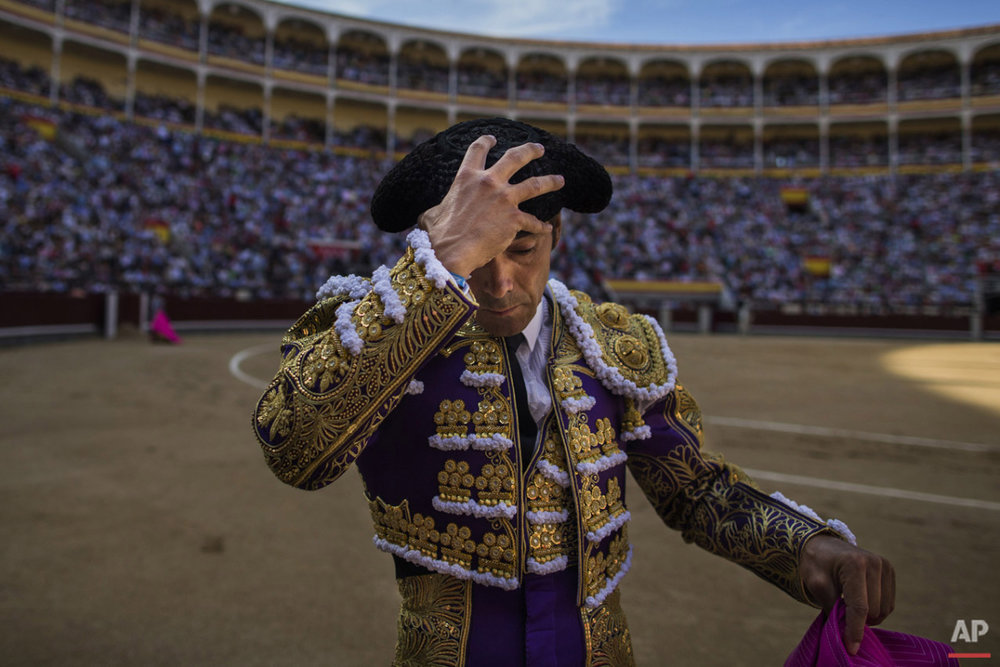 Bullfighter Manuel Jesus 'El Cid' gestures adjusts his montera hat as he gets ready to perform with a Victorino Martin ranch fighting bull during a bullfight at Las Ventas bullring in Madrid, Spain, Friday, June 5, 2015. Bullfighting is a traditional spectacle in Spain and the season runs from March to October.