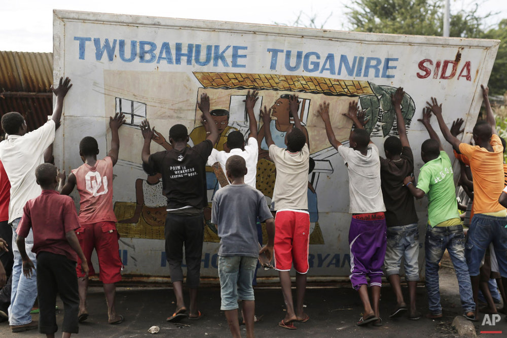 People set up a barricade in the Musaga district of Bujumbura, Burundi, Saturday May 9, 2015. (AP Photo/Jerome Delay)