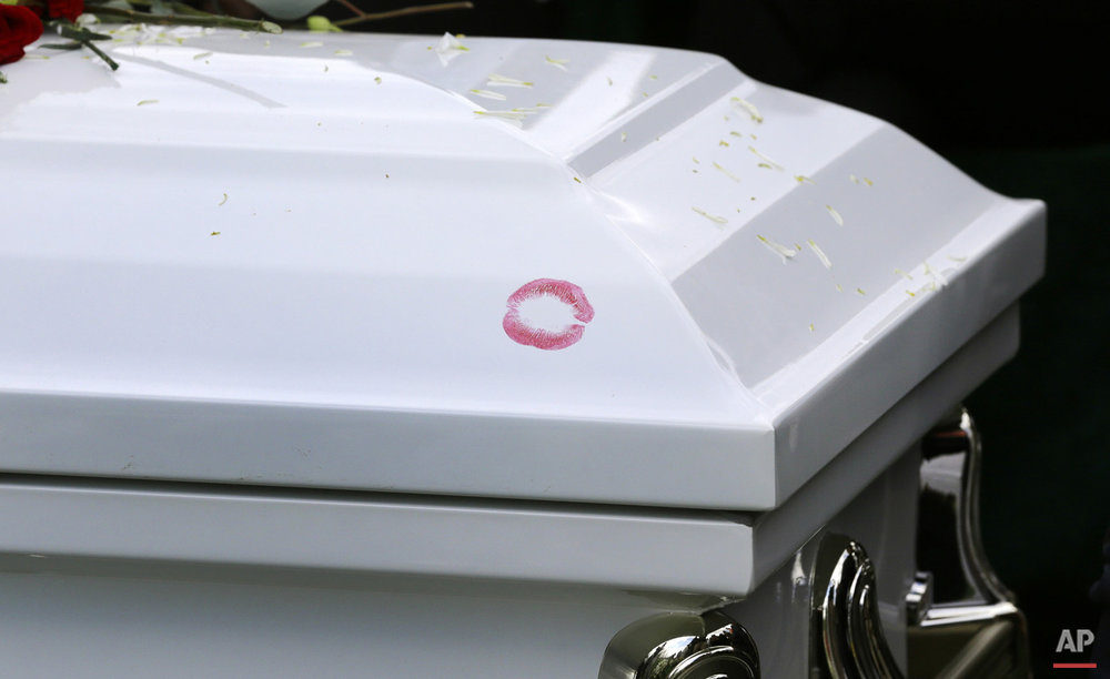 Lipstick marks Freddie Gray's casket at his burial, Monday, April 27, 2015, at Woodlawn Cemetery in Baltimore. (AP Photo/Patrick Semansky)