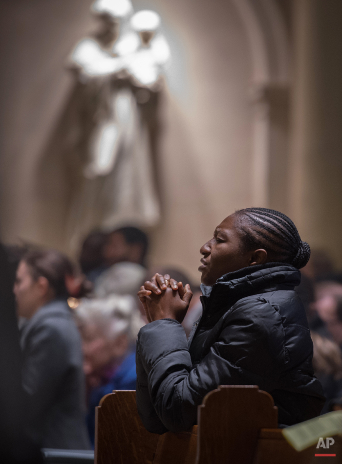 The faithful attend Mass offered in French at the Church of Notre Dame Sunday, Nov. 15, 2015, in New York where special prayers were said for victims of the terror attacks in Paris.  Friday's attacks on a stadium, a concert hall and Paris cafes left at least 129 people dead and over 350 wounded. In Paris the streets were enveloped in mourning, flags were lowered and Notre Dame Cathedral  ñ like many sites in Paris ñ was closed to tourists but a special church service was scheduled on Sunday for families of the victims. (AP Photo/Bryan R. Smith)