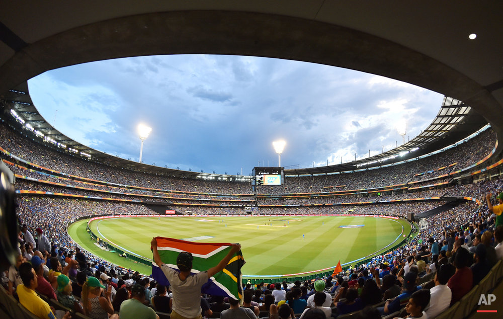 A South African fan holds up his national flag during their Cricket World Cup pool B match against India at the Melbourne Cricket Ground in Melbourne, Australia, Sunday, Feb. 22, 2015. (AP Photo/Theo Karanikos)