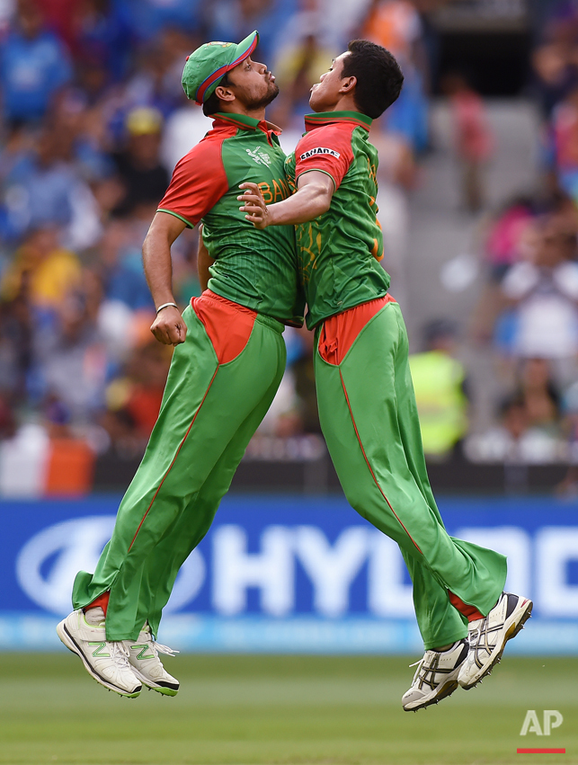 Bangladesh's Taskin Ahmed, right, celebrates with his teammate Mashrafe Mortaza after taking the wicket of India's Ajinkya Rahane during their Cricket World Cup quarterfinal match in Melbourne, Australia, Thursday, March 19, 2015. (AP Photo/Andy Brownbill)