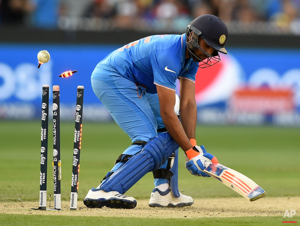India's Rohit Sharma is bowled for 137 runs while batting against Bangladesh during their Cricket World Cup quarterfinal match in Melbourne, Australia, Thursday, March 19, 2015. (AP Photo/Andy Brownbill)