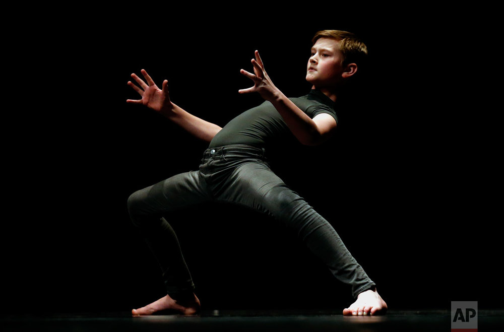Hans Anderson performs in the Youth America Grand Prix regional semi-finals at Dominican University Performing Arts Center, Friday, Feb. 3, 2017, in River Forest, Ill. Chicago is one of the 12 cities in North America selecting dancers who will compete in New York in April. (AP Photo/Nam Y. Huh)