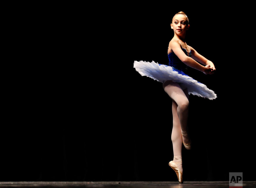 Samantha Srebnik performs in the classical category for the Youth America Grand Prix regional semi-finals at Dominican University Performing Arts Center in River Forest, Ill., on Thursday, Feb. 2, 2017. Hundreds of dancers between the ages of nine and 19 from the Chicago area auditioned for the YAGP regional semi-finals. (AP Photo/Nam Y. Huh)