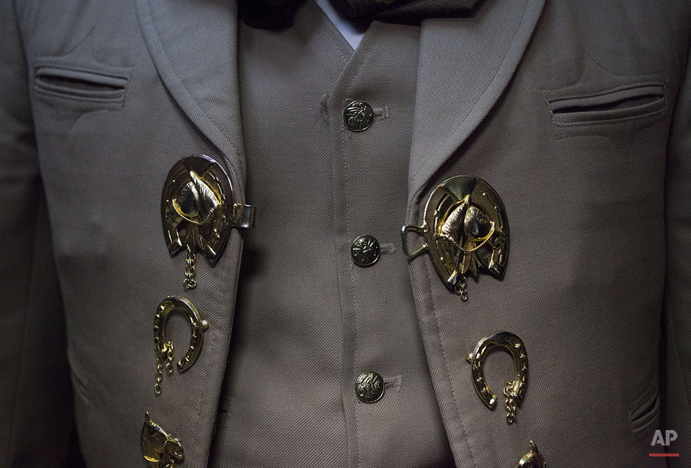 "This Aug. 17, 2015 photo shows the decorative vest buttons and accessories on the three-piece suit of a mariachi musician inside the Salon Tenampa bar and restaurant in Garibaldi Plaza in Mexico City. ""It's like a symbol of Mexico,"" said the restaurant's founder, Juan I. Hernandez, pointing out that UNESCO named mariachi music an ""intangible cultural heritage"" in 2011.  (AP Photo/Sofia Jaramillo)"