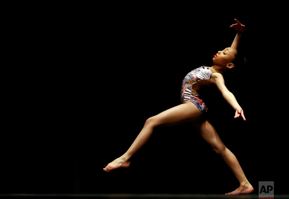 Cienna Cocilova performs in the contemporary category for the Youth America Grand Prix regional semi-finals at Dominican University Performing Arts Center in River Forest, Ill., on Thursday, Feb. 2, 2017. Chicago is one of the 12 cities in North America selecting dancers who will compete in New York in April. (AP Photo/Nam Y. Huh)