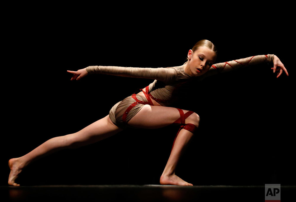 Emma Donnelly performs in the contemporary category for the Youth America Grand Prix regional semi-finals at Dominican University Performing Arts Center in River Forest, Ill., on Thursday, Feb. 2, 2017. Chicago is one of the 12 cities in North America selecting dancers who will compete in New York in April. (AP Photo/Nam Y. Huh)