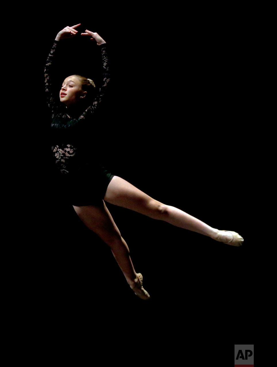 Jordan Dawson performs in the Youth America Grand Prix regional semi-finals at Dominican University Performing Arts Center, Friday, Feb. 3, 2017, in River Forest, Ill. Chicago is one of the 12 cities in North America selecting dancers who will compete in New York in April. (AP Photo/Nam Y. Huh)