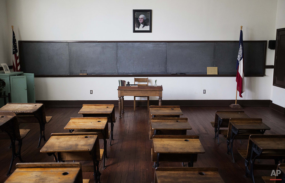 A classroom of former President Jimmy Carter from when he attended Plains High School in 1937 is exhibited in what is now the Jimmy Carter National Historic Site in his hometown of Plains, Ga., Saturday, Aug. 22, 2015. Carter remains the biggest draw for Plains visitors. He plans to continue teaching Sunday school at the small Baptist church he and his wife, Rosalynn, attend. (AP Photo/David Goldman)