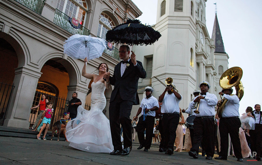 Newlyweds Todd Ledet and Megan Bendig dance their way out of St. Louis Cathedral at Jackson Square in the French Quarter of New Orleans, Saturday, Aug. 15, 2015. New Orleans is nearly three centuries old, mixing African-American, French, Spanish and Caribbean traditions to create unique forms of music, food and culture found nowhere else in America. (AP Photo/Max Becherer)