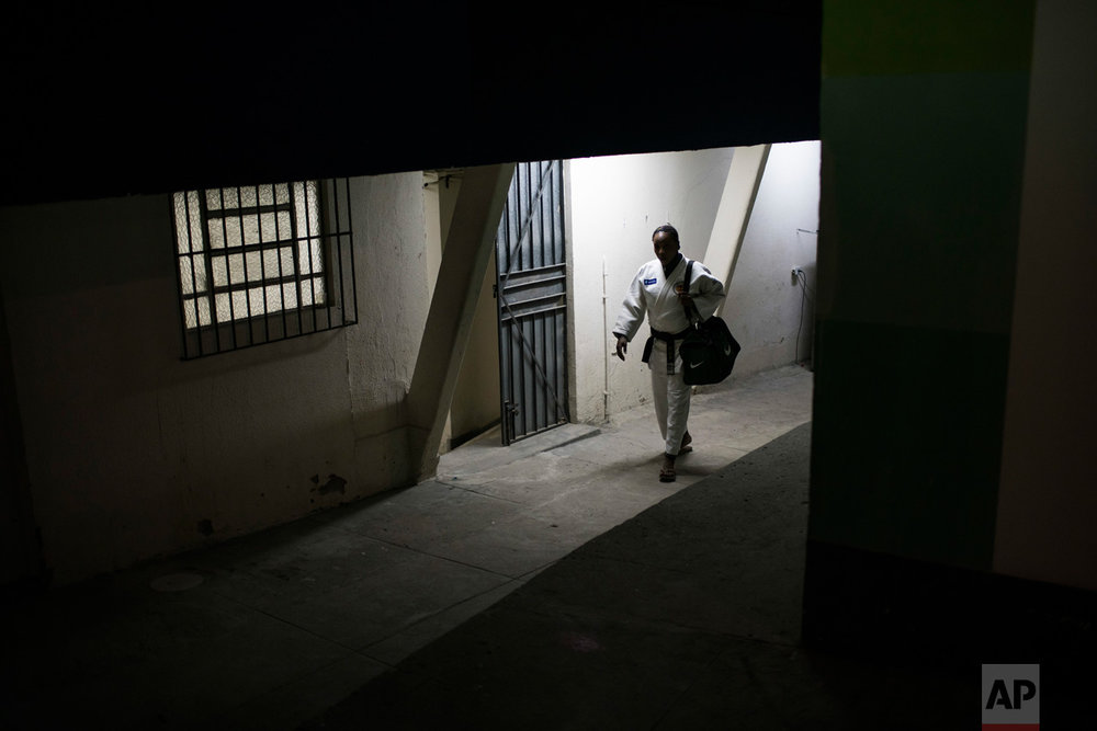 In this May 27, 2016 photo, Yolande Mabika, a refugee from the Democratic Republic of Congo, walks to judo training at the Reacao Institute in Rio de Janeiro, Brazil, in hopes of making the cut for the first Olympic refugee team. Getting to the point of possibly competing in the Summer Games this August in Rio de Janeiro has been a long road. (AP Photo/Felipe Dana)