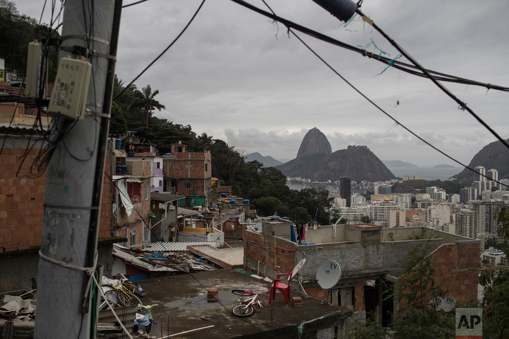 The Sugar Loaf mountain, top right, is pictured from the Dona Marta slum during the 2016 Summer Olympics in Rio de Janeiro, Brazil, Wednesday, Aug. 10, 2016. (AP Photo/Felipe Dana)