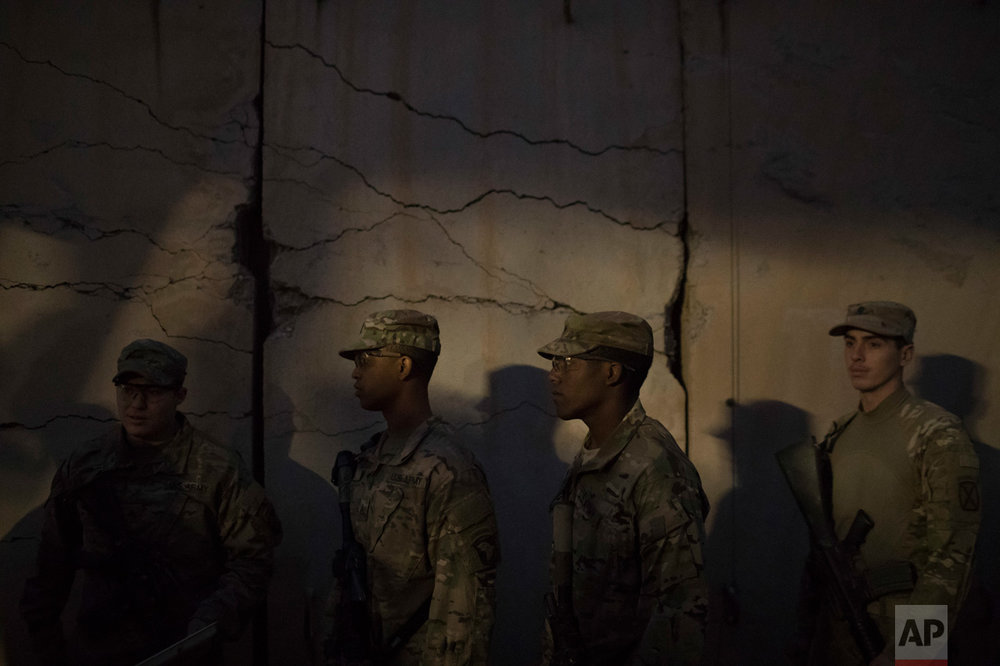 U.S. military personnel wait in line for Thanksgiving dinner at a coalition air base in Qayara south of Mosul, Iraq, Thursday, Nov. 24, 2016. (AP Photo/Felipe Dana)