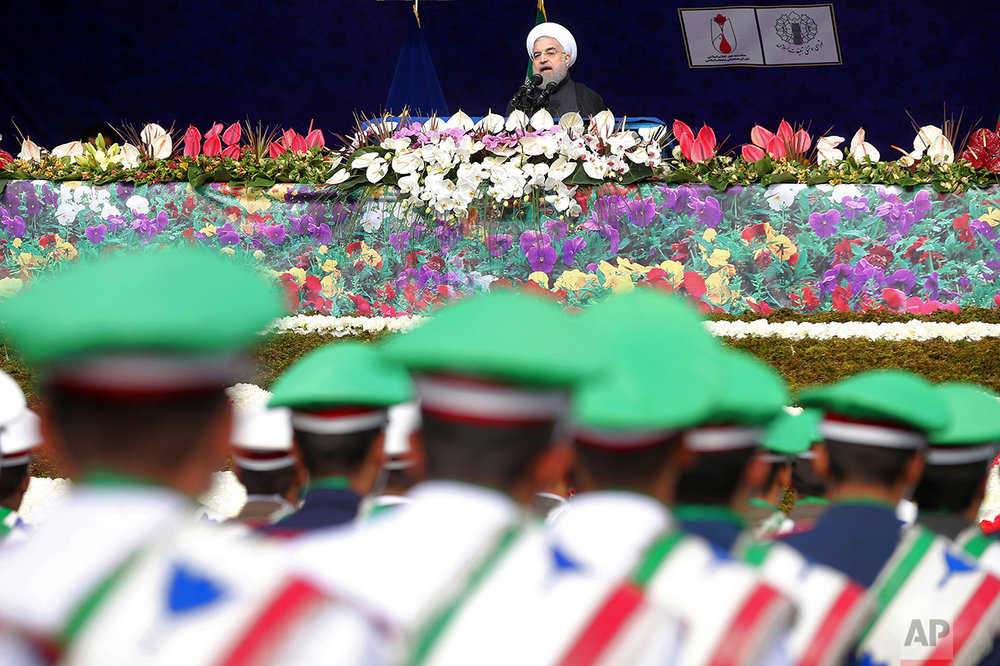 Iranian President Hassan Rouhani delivers a speech during an annual rally commemorating the anniversary of the 1979 Islamic revolution, which toppled the late pro-U.S. Shah, Mohammad Reza Pahlavi, in Tehran, Iran, Friday, Feb. 10, 2017. (AP Photo/Ebrahim Noroozi)