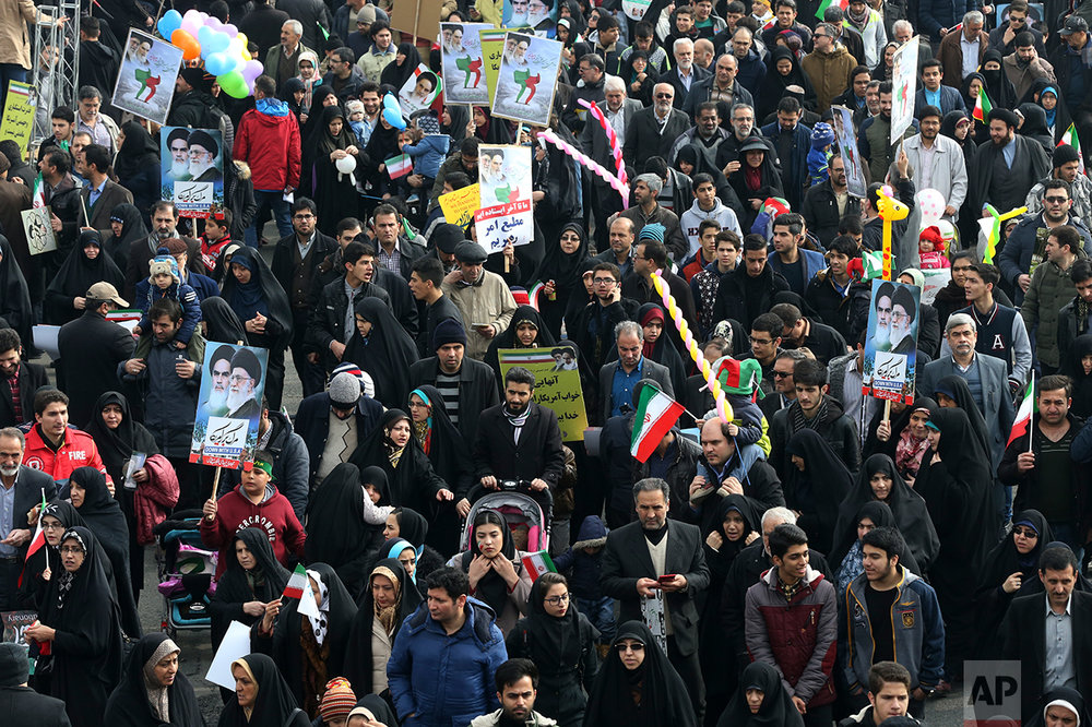 Iranians march in an annual rally commemorating the anniversary of the 1979 Islamic revolution, which toppled the late pro-U.S. Shah, Mohammad Reza Pahlavi, in Tehran, Iran, Friday, Feb. 10, 2017. (AP Photo/Vahid Salemi)