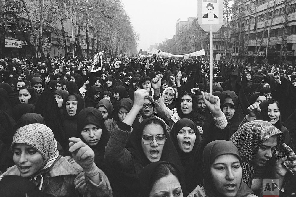 In this Dec. 10, 1978 picture, thousands crowd the streets during demonstrations against the Shah in Tehran. The popular revolt against the shah raised alarm bells in the West, which saw the shah as a trusted ally and counterweight to hard-line Arab regimes and Palestinian radicals. The face of the revolution was Ayatollah Ruhollah Khomeini, whose demeanor, vehemently anti-American rhetoric and stern interpretation of Islam challenged not only Western interests but also Western values. (AP Photo)