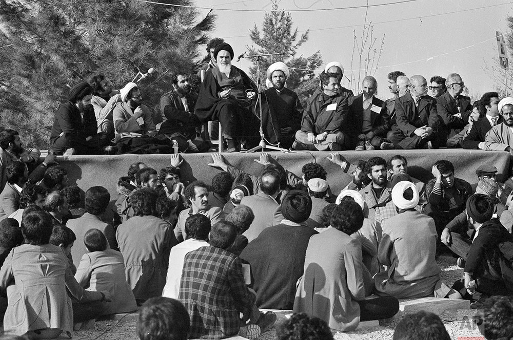 The Ayatollah Khomeini speaks to followers at Behesht Zahra Cemetery after his arrival in Tehran, Iran, ending 14 years of exile, Feb. 1 , 1979. Khomeini prayed for the victims of the Islamic struggle against the Shah of Iran. (AP Photo/FY)