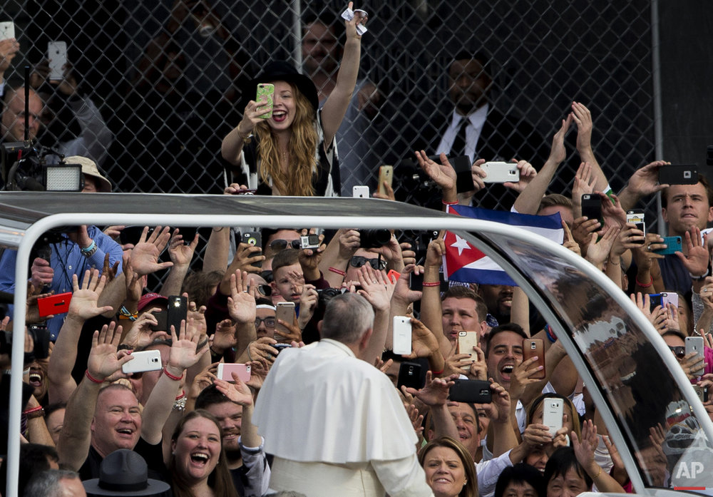 Pope Francis passes a crowd in his pope mobile on Independence Mall in Philadelphia on Saturday, Sept. 26, 2015. The pope spoke at Independence Hall on his first visit to the United States. (AP Photo/Laurence Kesterson, pool)