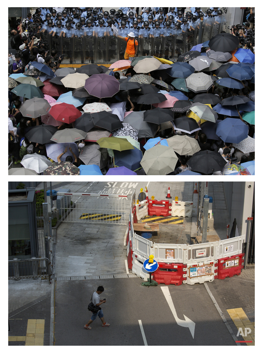 "This combination of Sept. 27, 2014 file, top, and Sept. 26, 2015, photos shows a protester holding a placard that reads: ""Occupy Central"" between anti-riot policemen and protesters outside the government headquarters during the Umbrella Movement in Hong Kong, and the same area almost a year later. (AP Photo/Vincent Yu, File)"