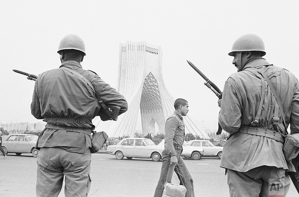 Iranian soldiers guard the route of a military parade near Shahyad Monument during 57th anniversary of the Armed Forces, Nov. 17, 1978 in Tehran. (AP Photo/Aristotle Saris)