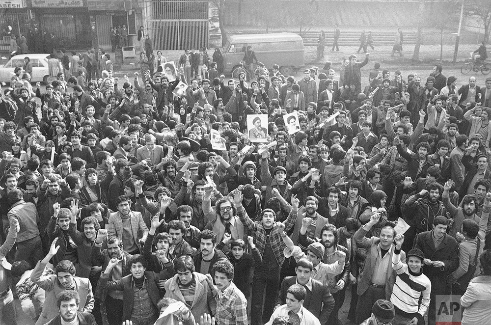 Thousands of Tehranians took to the streets, on Tuesday, Jan. 16, 1979 in Tehran, Iran after word had spread, that the Shah Mohammad Reza Pahlavi had left the country seeking medical care and exile. (AP Photo/Saris)