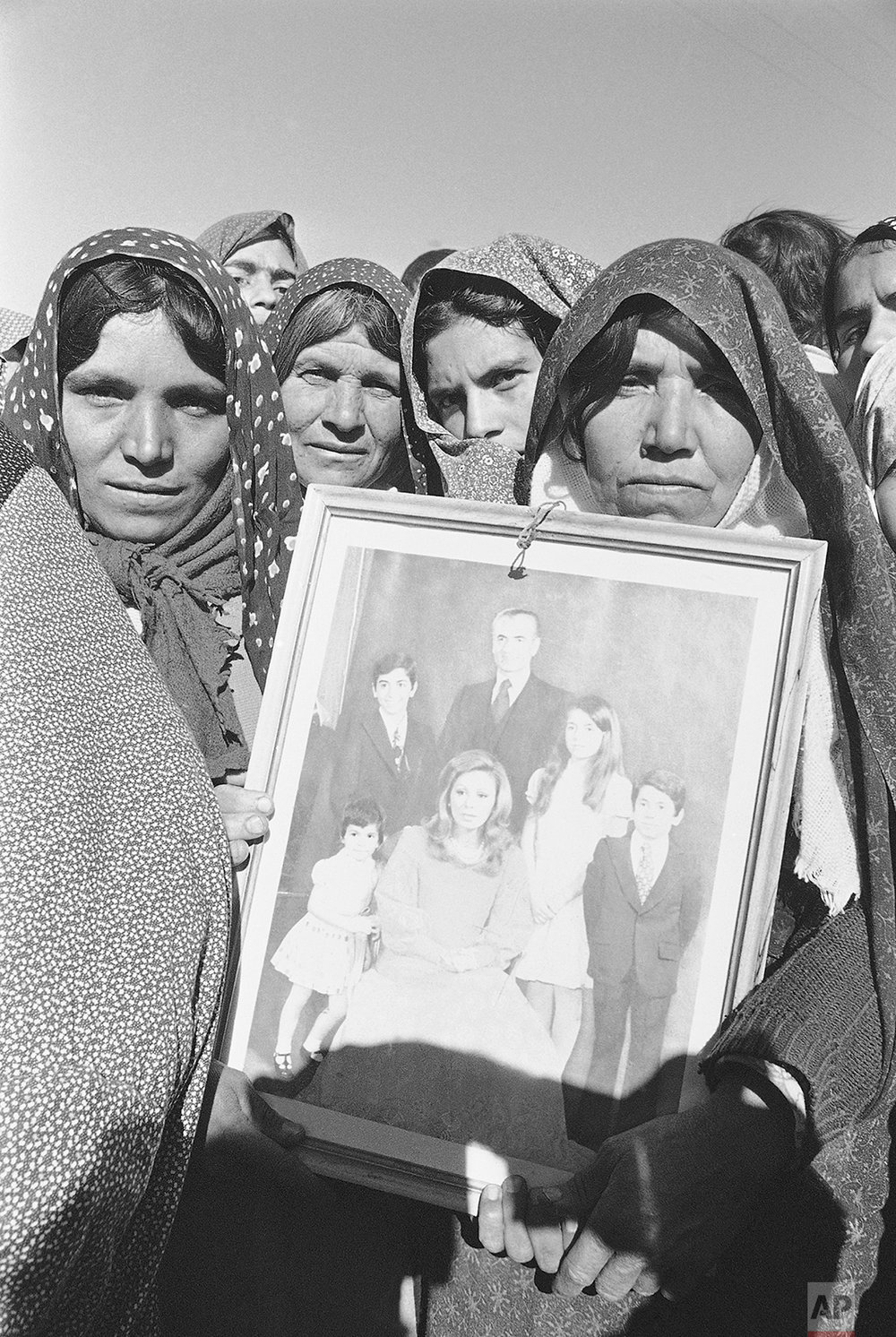A group of women in Tiran, central Iran, show their support for the Shah by carrying a portrait of the royal family during a loyalist demonstration Nov. 30, 1978. The monarch enjoys some of his strongest support in the country's rural areas. (AP Photo)