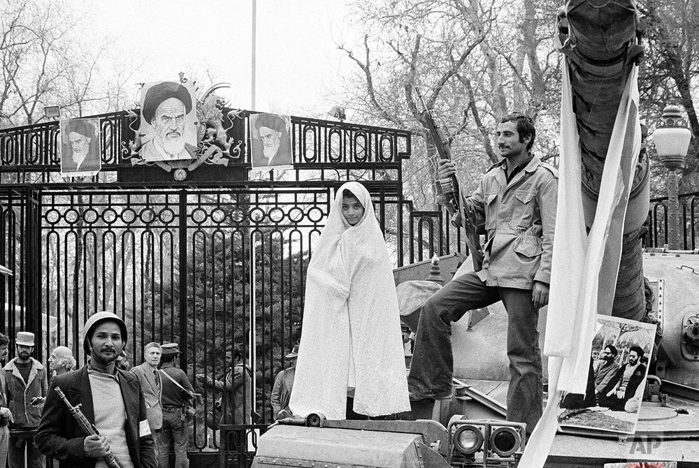 A small Iranian girl stands on a captured tank at the entrance to Niavaran palace where the Shah once lived, 1979. (AP Photo/Aristotle Saris)
