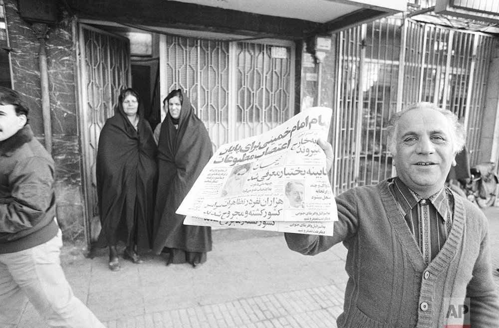 A vendor holds the first edition of the Tehran national newspaper Kayhan in Tehran, which like other papers was published after 62 days or shut down due to martial law, Jan. 6, 1979, Iran. (AP Photo)