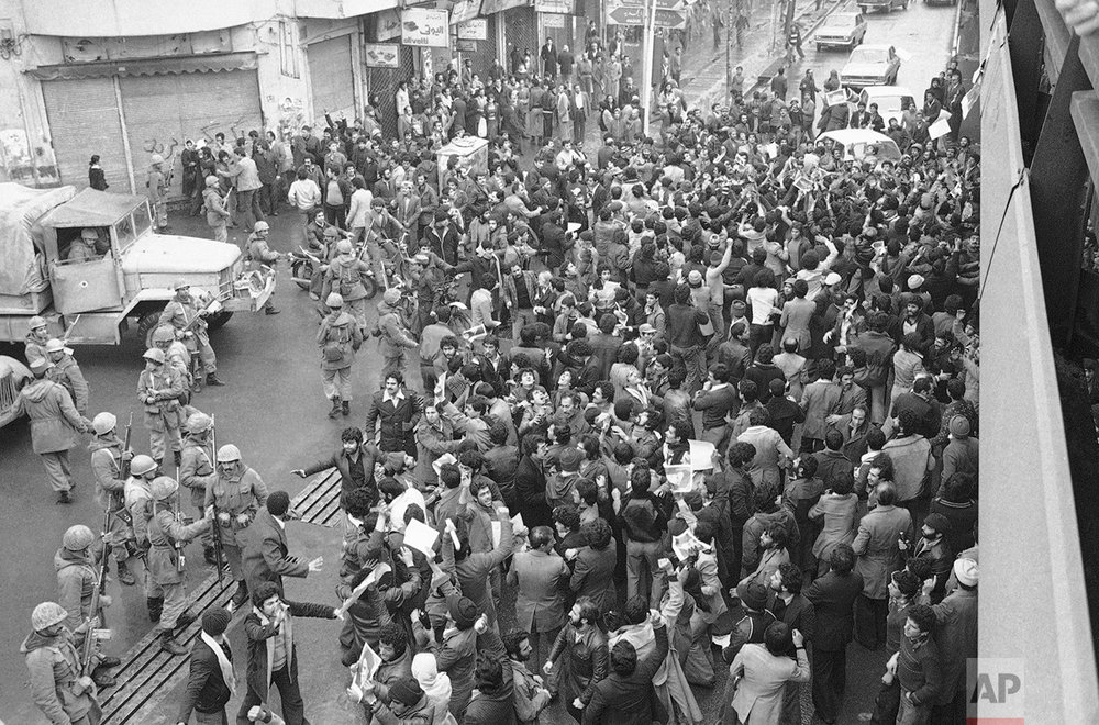 Demonstrators and the Iranian army are back in Tehran streets, on Wednesday, Jan. 24, 1979 after word had spread that the army sealed off Tehran airport to prevent an Iran Airlines jumbo from take off for Paris, where it was supposed to bring back to Iran the Ayatollah Khomeini, Iran's religious leader, Friday. (AP Photo/ Bob Dear)