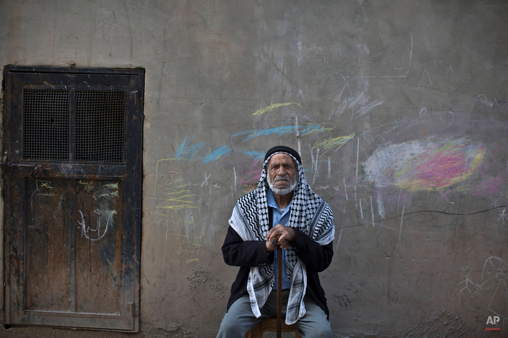 In this Wednesday, June 18, 2014 photo, Palestinian refugee Mahmoud Almansi, 79, poses for a picture in the West Bank refugee camp of Al-Amari, where he has lived since the age of 13. A lifetime has passed since hundreds of thousands of Palestinians fled or were forced out their homes in the Mideast war over Israel's 1948 creation. Today, those who were uprooted and their descendants number more than 5 million people, scattered across the West Bank, Gaza Strip, Jordan, Syria and Lebanon. (AP Photo/Muhammed Muheisen)