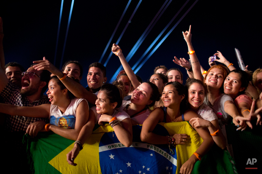 Fans watch the 'Tribute to Cazuza' show during the Rock in Rio music festival in Rio de Janeiro, Brazil, Friday, Sept. 13, 2013. (AP Photo/Felipe Dana)