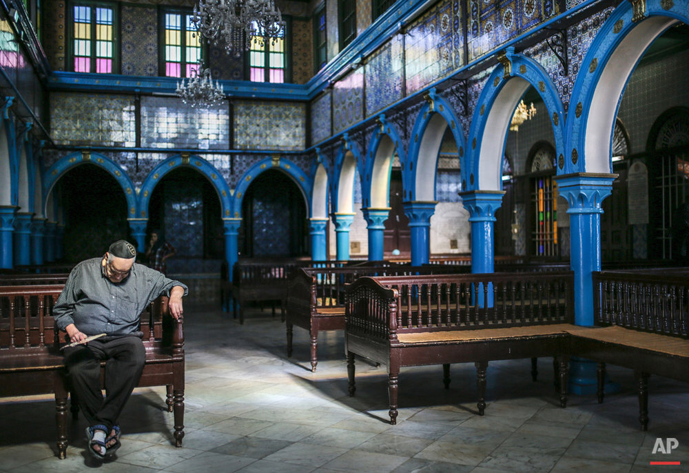 In this Wednesday, Oct. 28, 2015 photo, a Jewish man rests in La Ghriba, the oldest synagogue in Africa, on the Island of Djerba, southern Tunisia. The Jewish community in the resort island of Djerba traces its roots all the way back to Babylonian exile of 586 B.C., and is one of the few communities of its kind to have survived the turmoil around the creation of Israel, when more than 800,000 Jews across the Arab world either emigrated or were driven from their homes. (AP Photo/Mosa'ab Elshamy)