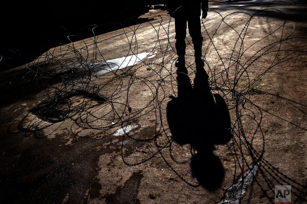A shadow of an Indian paramilitary soldier is cast on barbed wire at a checkpoint during curfew in Srinagar, Indian controlled Kashmir, Friday, Feb. 10, 2017. Authorities imposed a curfew in some parts of Indian-controlled Kashmir's main city to prevent a protest march to the disputed Himalayan region's office of United Nations Military Observer Group in India and Pakistan (UNMOGIP) called by separatist leaders seeking end of Indian rule. (AP Photo/Dar Yasin)