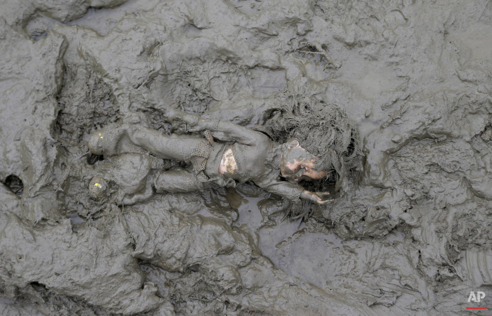 A doll lies in the mud after being left behind close the border with Croatia near the village of Zakany, Hungary, Saturday, Oct. 17, 2015.  (AP Photo/Petr David Josek)