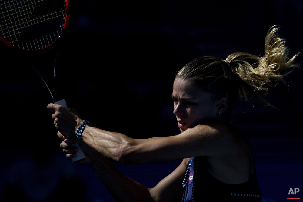 In this Saturday, Oct. 3, 2015 photo, Camila Giorgi of Italy returns a ball against Timea Bacsinszky of Switzerland during the China Open tennis tournament at the National Tennis Stadium in Beijing. (AP Photo/Andy Wong, File)