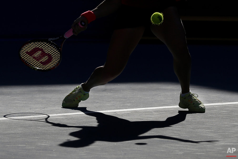 Anastasia Pavlyuchenkova of Russia returns a ball against Flavia Pennetta of Italy during their women's singles match of the China Open tennis tournament at the National Tennis Stadium in Beijing, Thursday, Oct. 8, 2015. (AP Photo/Andy Wong)