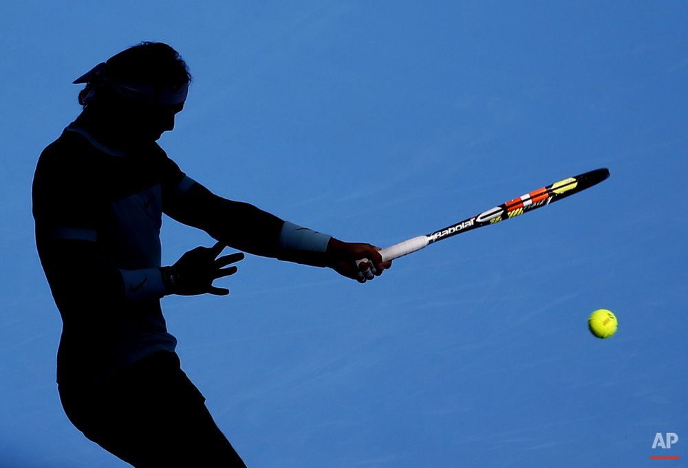 Rafael Nadal of Spain hits a return shot against Jack Sock of the United States during their men's singles quarterfinal match of the China Open tennis tournament at the National Tennis Stadium in Beijing, Friday, Oct. 9, 2015. (AP Photo/Andy Wong)