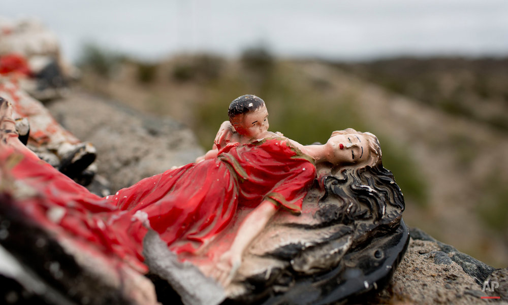 "In this Nov. 2, 2014 photo, a small statue of Deolinda Correa, better known as ""La Difunta Correa,"" lays at her sanctuary in Vallecito in the San Juan province of Argentina, where pilgrims come to thank her for answering their prayers. She's one of Argentinaís most popular folk saints, who legend has it set out into the desert with her baby in her arms to find her ill husband who had been forcibly recruited to fight in Argentinaís civil war in the 19th century. Deolinda Correa died of thirst. When gaucho cattle herders found her body under a tree, they discovered that her baby was still alive, nourished by her breasts which ìmiraculouslyî remained filled with milk after her death. (AP Photo/Natacha Pisarenko)"