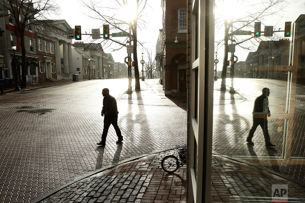 A pedestrian walks along Gay Street in West Chester, Pa., Wednesday, Jan. 4, 2017. Chester is the richest county in Pennsylvania; it is majority Republican, but Democratic presidential candidate Hillary Clinton won here easily in 2016. (AP Photo/Matt Rourke)
