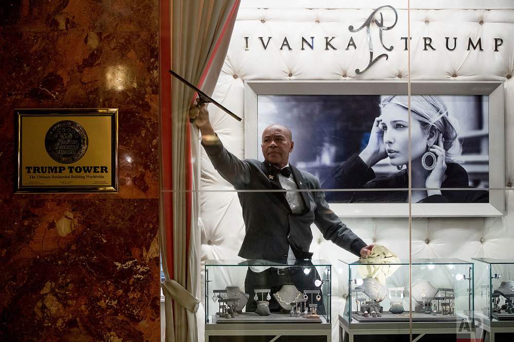A worker cleans the windows of the Ivanka Trump Collection in the lobby of Trump Tower in New York, Tuesday, Jan. 17, 2017. (AP Photo/Andrew Harnik)