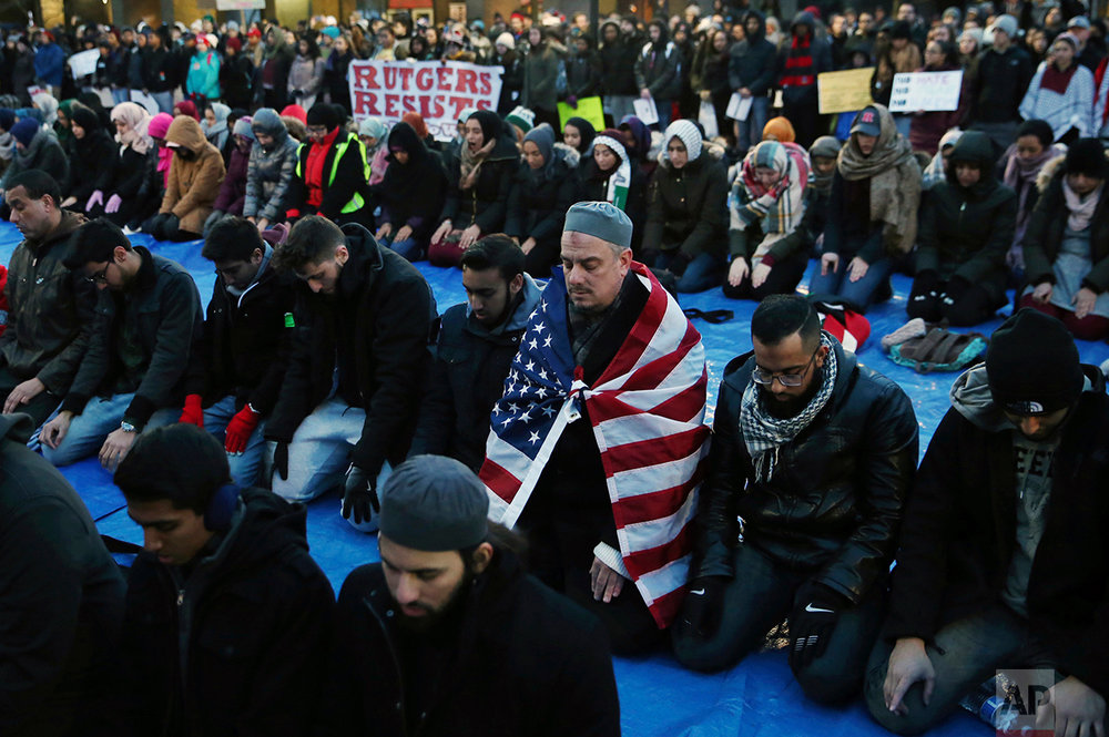 Rutgers University students and supporters gather for Muslim Prayers during a rally to express discontent with President Donald Trump's executive order halting some immigrants from entering the United States on Tuesday, Jan. 31, 2017, in New Brunswick, N.J. (AP Photo/Mel Evans)